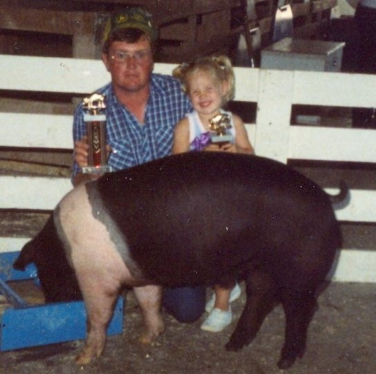 Dad and I with Barrel the Pig after winning the county fair open show in 1985