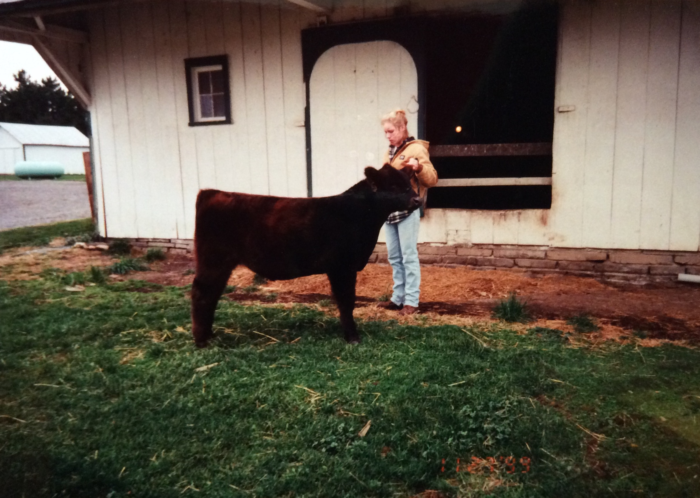 Tigger the Steer and I in front of the barn at my childhood home